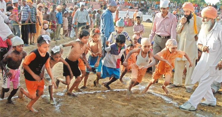 Children's races at  Seechewal Stadium